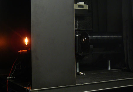 Figure 1. The 1,000 W Standard of Spectral Irradiance being slowly ramped up during an irradiance calibration. The radiometer at the right of the image is the OSPREy Transfer Radiometer for irradiance measurements.